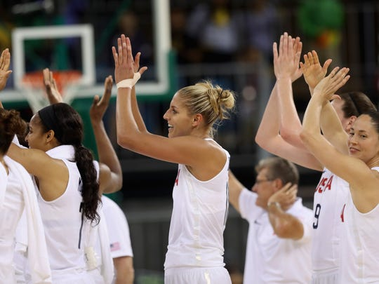 RIO DE JANEIRO, BRAZIL - AUGUST 10: Elena Delle Donne #11 of United States (C) and teammates celebrate their 110-84 win over Serbia in the Women's Basketball Preliminary Round Group B match between China and Spain on Day 5 of the Rio 2016 Olympic Games at Youth Arena on August 10, 2016 in Rio de Janeiro, Brazil.  (Photo by Rob Carr/Getty Images)