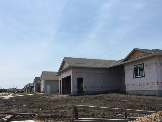 A new home under construction on a growing development