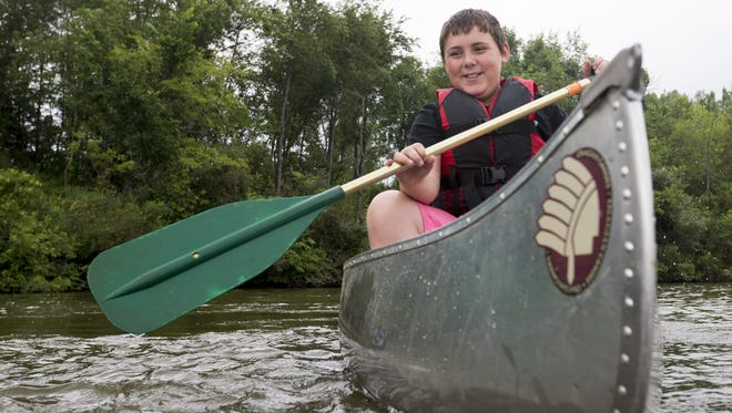 Isaac Bailey of Des Moines perfects his paddling technique while attending a summer skills day camp at Easter Lake Park in 2015.