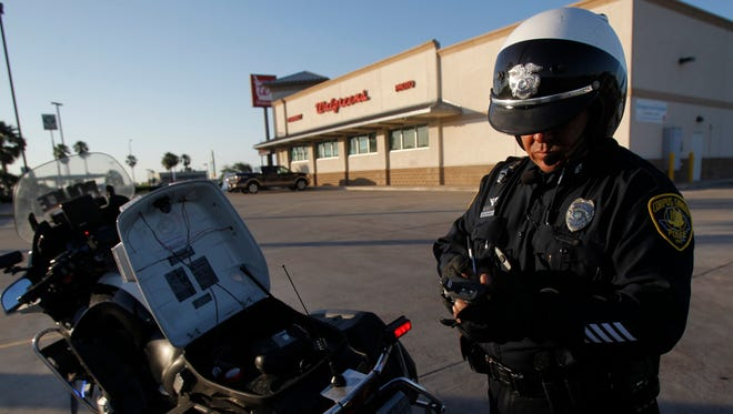 Senior Officer Robert Nuñez pulls up information on the last ticket he issued Thursday, May 15, 2014 as members of the Corpus Christi Police Department's traffic division get an early start looking for speeders on South Padre Island Drive in Corpus Christi.