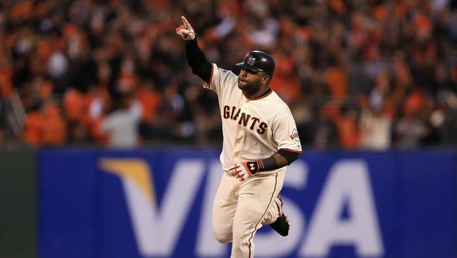 Pablo Sandoval of the San Francisco Giants rounds the bases after hitting a solo home run against Al Alburquerque of the Detroit Tigers in the fifth inning during Game 1 of the 2012 World Series at AT&T Park in San Francisco.