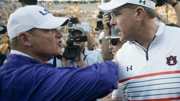 LSU head coach Les Miles shakes Auburn Tigers head coach Gus Malzahn hand after the NCAA football game between LSU Tigers and Auburn on Saturday, Sept. 19, 2015, at Tiger Stadium in Baton Rouge, La. LSU Tigers defeated Auburn Tigers 45-21.Albert Cesare / Advertiser