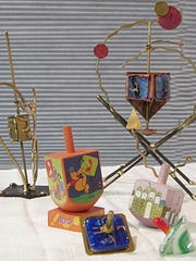 Assorted art dreidels from the Joan Lorber Collection.