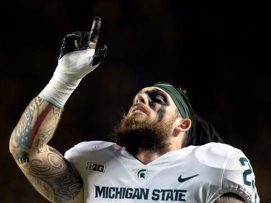 Michigan State's Chris Frey points to the sky after
