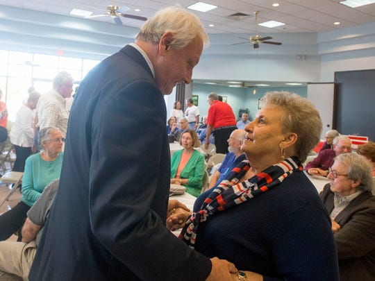 Senator Jim Mathias greets supporter Arlene Page during a break in a debate with candidate Mike McDermott on Wednesday, Oct. 8 at the Ocean City Senior Center.