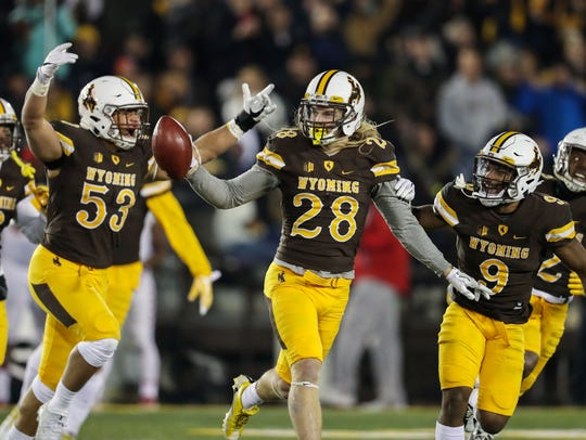 Wyoming safety Andrew Wingard (28) celebrates an interception