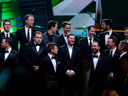 Drivers take the stage during the NASCAR Sprint Cup Series auto racing awards Friday, Dec. 4, 2015, in Las Vegas. (AP Photo/Isaac Brekken)