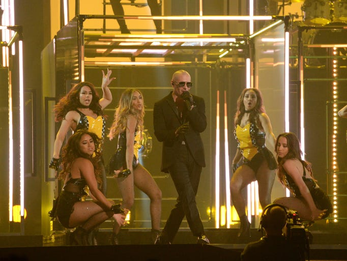 Pitbull performs with during the 58th Grammy Awards.