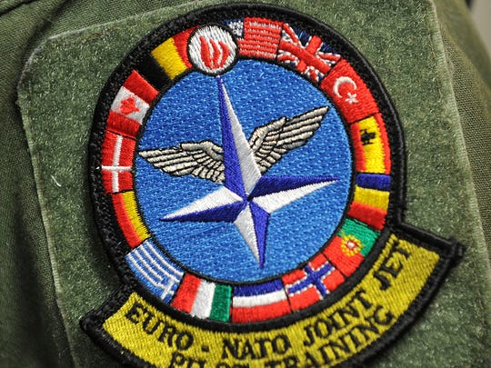 The shoulder patches of the 80th Flying Training Wing personnel have been updated to include the red, blue and yellow flag of Romania, lower right, as the 14th country to join the Euro-NATO Joint Jet Pilot Training program at Sheppard Air Force Base. Romanian instructor pilots should begin arriving in the Fall.