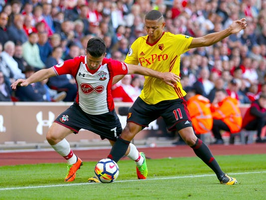 Southampton's Shane Long, left, and Watford's Richarlison battle for the ball during the English Premier League soccer match at St Mary's Stadium, Southampton, England, Saturday Sept. 9, 2017. (Steven Paston/PA via AP)
