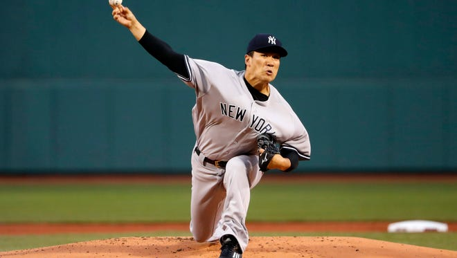 Apr 27, 2017; Boston, MA, USA; New York Yankees starting pitcher Masahiro Tanaka (19) delivers against the Boston Red Sox during the first inning at Fenway Park. Mandatory Credit: Winslow Townson-USA TODAY Sports