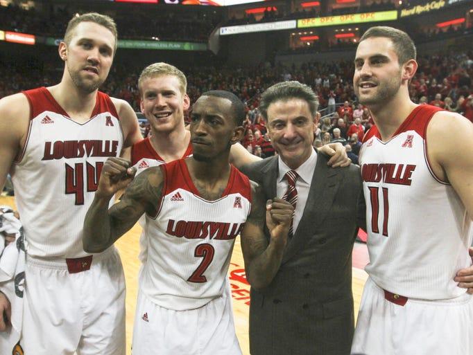 Louisville head coach Rick Pitino and his seniors Stephan Van Treese, Tim Henderson, Russ Smith and Luke Hancock at the KFC Yum! Center. March 8, 2014.
