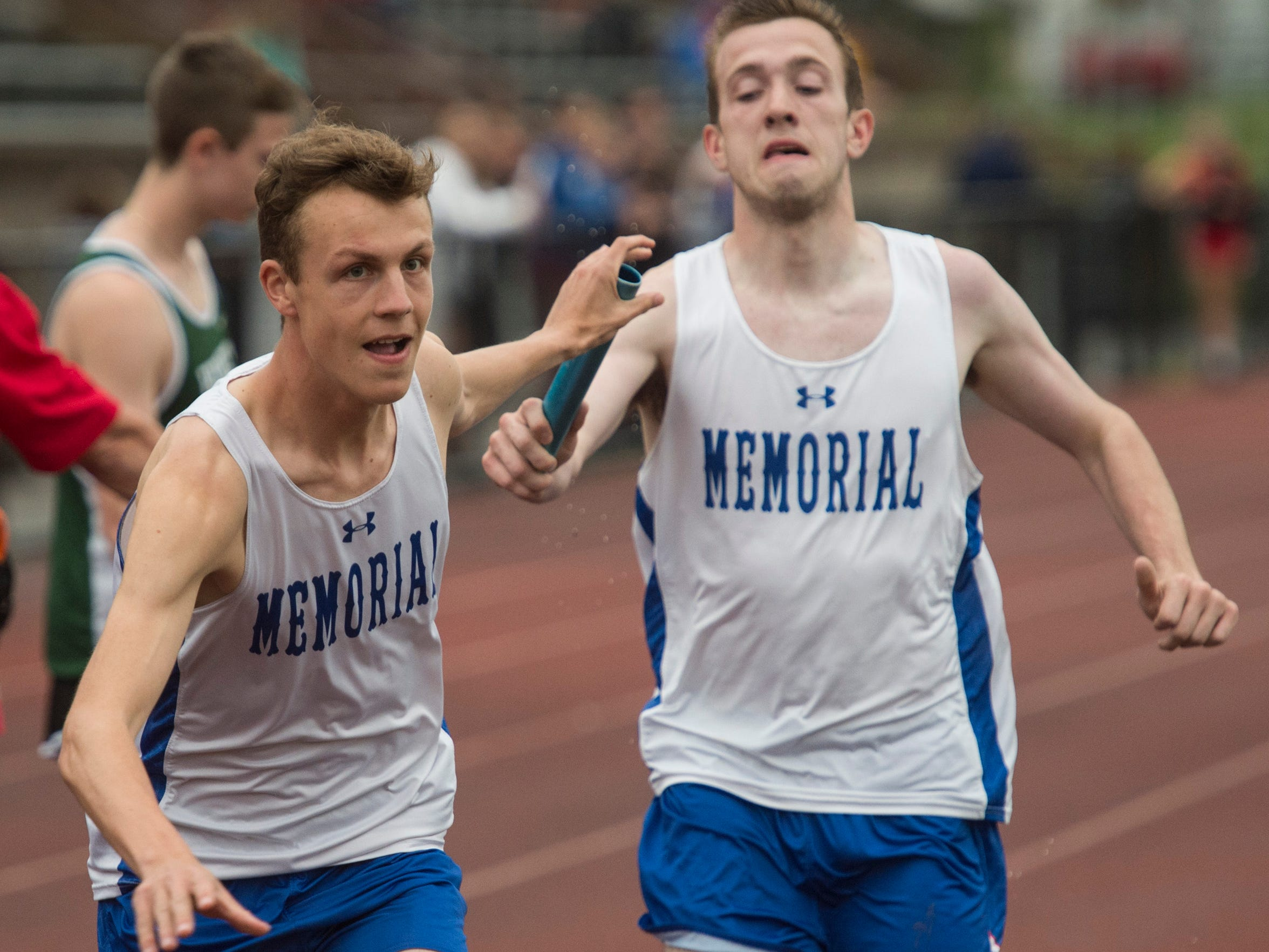 Memorial's Matthew Schadler, left, grabs the baton from teammate Andrew Cross during the boys 3200 meter relay during the first day of the SIAC track meet at Central High School on Tuesday, May 3, 2018.