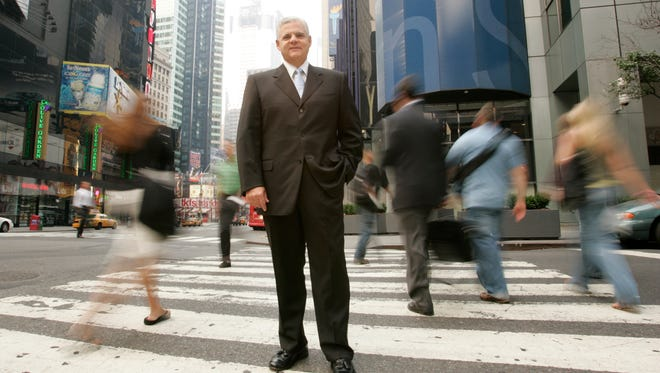 Joseph M. Tucci, President and CEO of data storage giant EMC is photographed on Broadway in Midtown Manhattan.