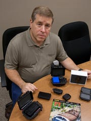 Jimmie Mesis, Manalapan, a licensed private investigator, with some of the GPS tracking devices used today- September 25, 2014-Manalapan, NJ. Staff photographer/Bob Bielk/Asbury Park Press