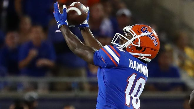 Aug 24, 2019; Orlando, FL, USA; Florida Gators wide receiver Josh Hammond (10) catches there ball against the Miami Hurricanes during the second half at Camping World Stadium. Mandatory Credit: Kim Klement-USA TODAY Sports