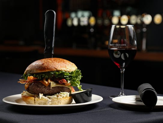 The Miller, the signature 3/4 pound burger, topped