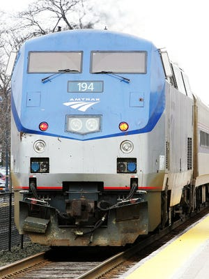 Amtrak's Hiawatha train from Milwaukee to Chicago departs from a stop at the Amtrak station in Glenview, Ill., in 2005.