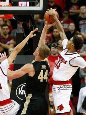 U of L's Ray Spalding (13) defends Purdue's Isaac Haas (44) during their game at the KFC Yum! Center.  