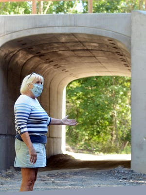 Kathie Hess, of Modock Road in Pomfret, talks about closed roads and detours Monday as two tunnels are built for an extension of the Air Line Trail in Pomfret. See videos at NorwichBulletin.com
