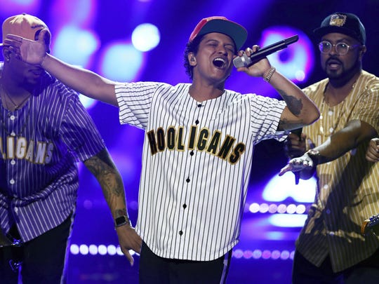 """FILE - In this Sunday, June 25, 2017, file photo, Bruno Mars performs """"Perm"""" at the BET Awards at the Microsoft Theater in Los Angeles. Mars was nominated for six Grammy nominations on Tuesday, Nov. 28. The 60th Annual Grammy Awards will air on CBS, Sunday, Jan. 28, 2018 in New York. (Photo by Matt Sayles/Invision/AP, File)"""