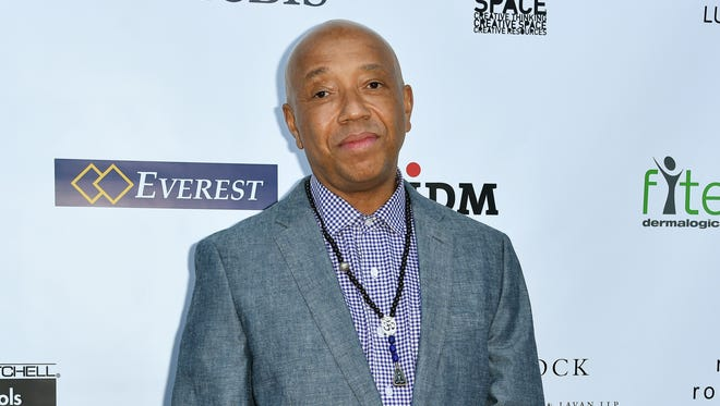 In this May 21, 2015 file photo, Russell Simmons arrives at The17th Annual CAST From Slavery to Freedom Gala in Los Angeles.