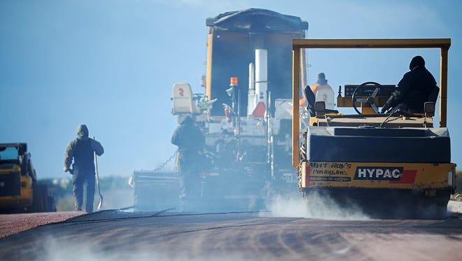 A crew with Myrl & Roy's Paving, Inc. pave a portion of East Willow Wood Street Wednesday Oct. 28, 2015, in eastern Sioux Falls.