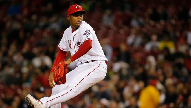 Cincinnati Reds relief pitcher Raisel Iglesias (26) delivers in the eighth inning during the interleague baseball game between the New York Yankees and the Cincinnati Reds, Tuesday, May 9, 2017, at Great American Ball Park in Cincinnati.