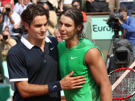 Spanish player Rafael Nadal (R) conforts Swiss player