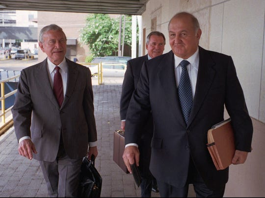 FILE PHOTO: Shreveport businessman Gus Mijalis, right, accompanied by attorney James Neal, walks into U.S. District Court in Alexandria, La., Thursday , June 11, 1998 for a hearing.