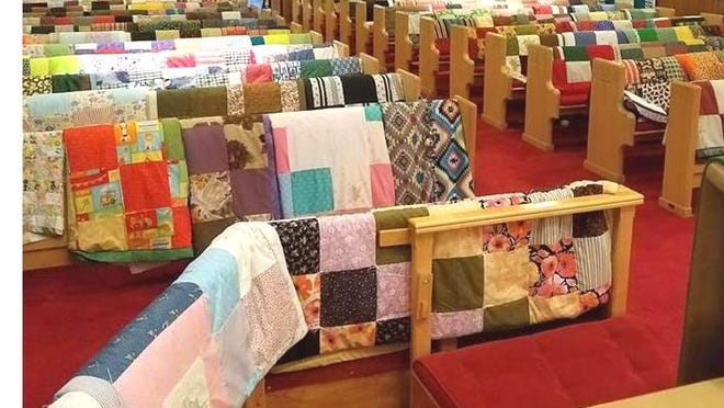 Piecemaker quilters from St. Paul's Evangelical Lutheran Church in Colon provide hundreds of quilts to Lutheran World Relief.
