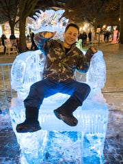 Ken Yamamoto tries the ice throne on Friday evening. He is in Michigan for training but lives in Japan.
