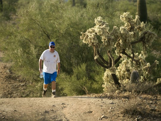 Pete Pawlowski of San Tan Valley, hikes along the Moonlight Trail in the San Tan Mountain Regional Park outside of Queen Creek on November 13, 2017.