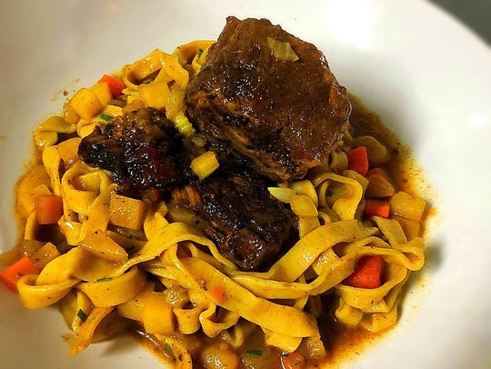 This Short Rib entree is served with pink peppercorn fettuccine and a 'chowder' demi glaze at C.C.'s Kitchen in Haddon Heights.