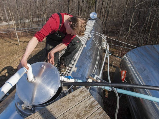 Roger Brown checks his sap holding tanks at Slopeside Syrup in Richmond on Tuesday, March 8, 2016.