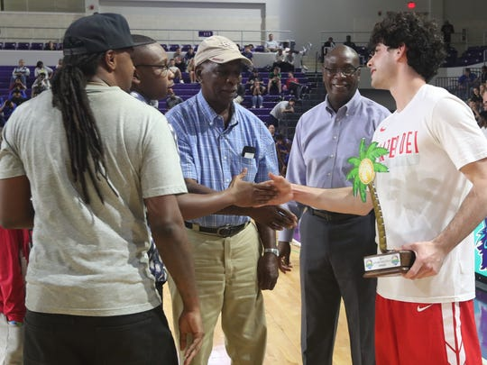Players shot for the top spot in the Three-point shooting contest that was part of the City of Palms Classic, Wednesday, Dec. 20, 2017. The winner was Spencer Freedman, Mater Dei, beating out Jordan McCabe, Kaukauna, Wisc. Teddy Dupay, 38, Former Mariner HS player, was also on hand to give a try at the competition and judge the Slam Dunk Contest.