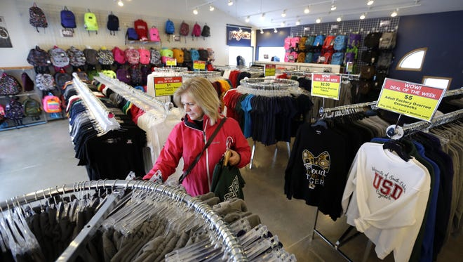 MaryBeth Barnes shops at the JanSport Factory Store Wednesday  in Greenville.