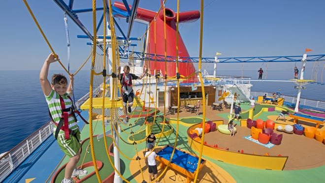 Young passengers climb the SkyCourse, a rope course aboard the Carnival Breeze, which will be based at Port Canaveral starting in September 2018.
