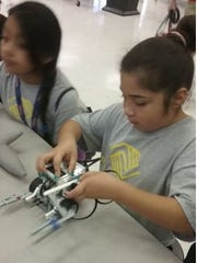 Children learn about teamwork, professionalism and accountability in addition to STEM in the robotics program at the Bill & Barbara Whitman Club in Indiantown