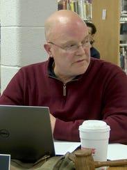 Burlington School Board Chairman Mark Porter reads