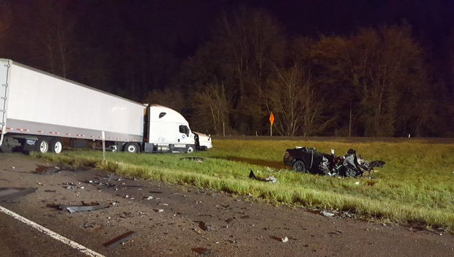 A driver headed the wrong way on I-5 Friday morning slammed head-on into a semi.