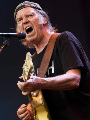 Neil Young and Crazy Horse perform on stage at British Summer Time Festival at Hyde Park on July 12, 2014, in London.