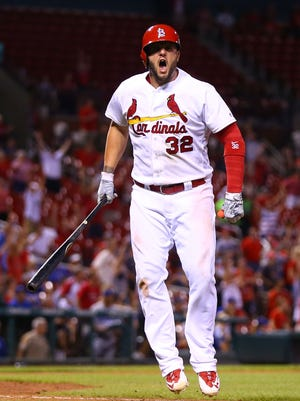 Matt Adams #32 of the St. Louis Cardinals celebrates after hitting a walk-off home run against the Los Angeles Dodgers int he sixteenth inning at Busch Stadium on July 22, 2016 in St. Louis, Missouri.  The Cardinals beat the Dodgers 4-3 in 16 innings.
