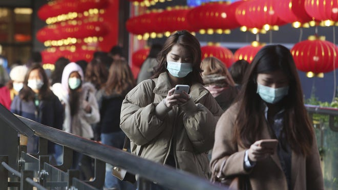 "People wear face masks and walk at a shopping mall in Taipei, Taiwan on January 31. Every year since taking office, the Trump administration has asked for deep cuts into research on emerging diseases - including the U.S. CDC's small center on emerging and ""zoonotic"" infectious diseases that jump the species barrier from animals to humans. The new coronavirus is just the latest example of these threats."