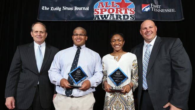 From left, First Tennessee President Phil Holt, Male Athlete of the Year winner Nick Boykin, Female Athlete of the Year winner Crystal Dangerfield and The Daily News Journal General Manager Sean Lupton pose for a picture after Sunday's banquet.