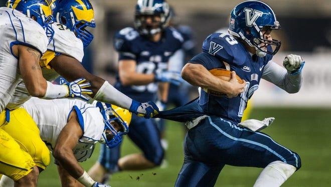 Delaware defensive lineman Zach Kerr holds on to Villanova quarterback John Robertson's jersey as he scrambles away in the fourth quarter of Delaware's 35-34 loss at PPL Park last season.
