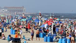 People fill the Avon beach on Labor Day 2017.