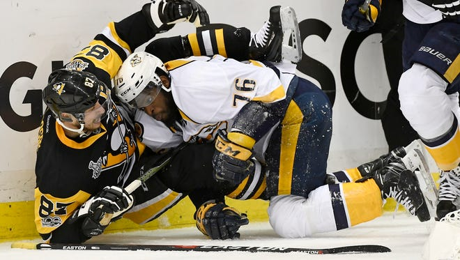 Penguins center Sidney Crosby (87) and Predators defenseman P.K. Subban (76) mix it up on a play they both got penalties for during the first period of Game 5 of the Stanley Cup Final on Thursday, June 8, 2017.