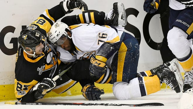 Penguins captain Sidney Crosby and Predators defenseman P.K. Subban tangle during the Stanley Cup Final.