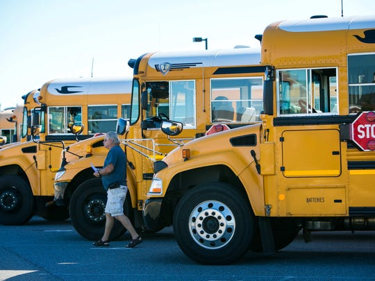 School buses line up outside an Appoquinimink School District building in this 2016 file photo.